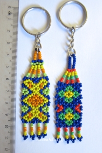 Keyfobs in assorted colours - Left- Vinusak (bud of the flower) - Right- Batu (flower in bloom) Traditional motifs by the native Rungus of Sabah, Borneo